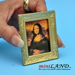 Painting of Mona Lisa with gold frame dollhouse miniature 1:12