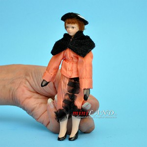 "Lady in Peach Porcelain doll  5.5""H"